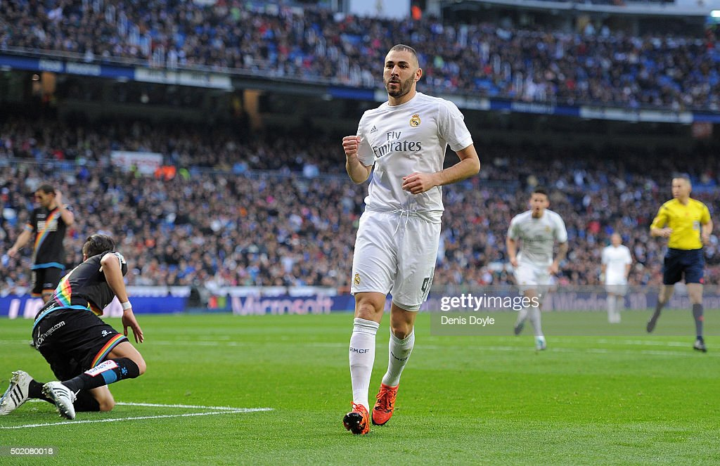 Karim Benzema of Real Madrid celebrates after scoring his team's 5th goal during the La Liga match between Real Madrid and Rayo Vallecano at estadio...