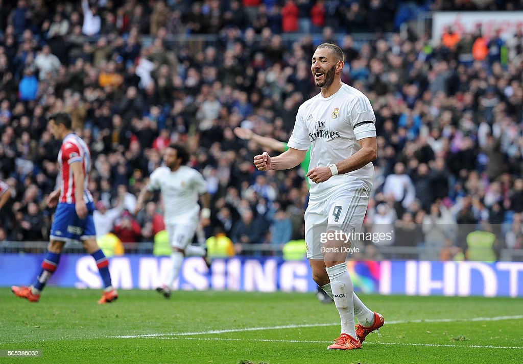 Karim Benzema of Real Madrid celebrates after scoring his team's 5th goal during the La Liga match between Real Madrid CF and Sporting Gijon at Estadio Santiago Bernabeu on January 17, 2016 in Madrid, Spain.