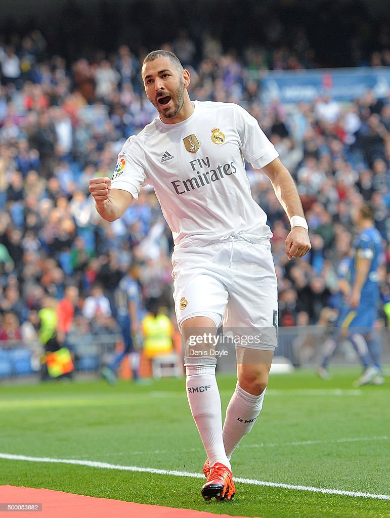 Karim Benzema of Real Madrid celebrates after scoring his team's opening goal during the La Liga match between Real Madrid CF and Getafe CF at Estadio Santiago Bernabeu on December 5, 2015 in Madrid, Spain.
