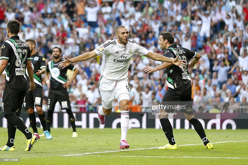 Karim Benzema of Real Madrid celebrates after scoring the opening goal during the La Liga match between Real Madrid CF and Cordoba CF at Estadio...