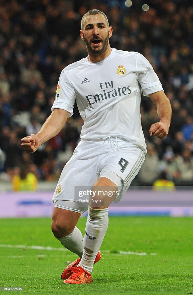 Karim Benzema of Real Madrid celebrates as he scores their fifth goal during the La Liga match between Real Madrid CF and RC Deportivo La Coruna at...