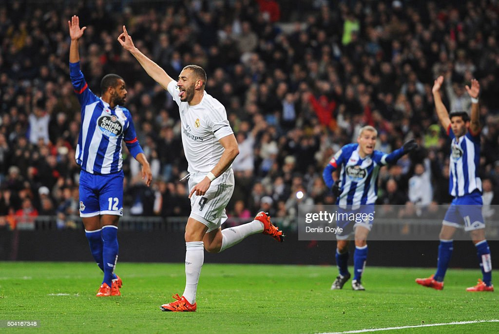 Karim Benzema of Real Madrid celebrates as he scores their first goal as Deportivo La Coruna players appeal during the La Liga match between Real...