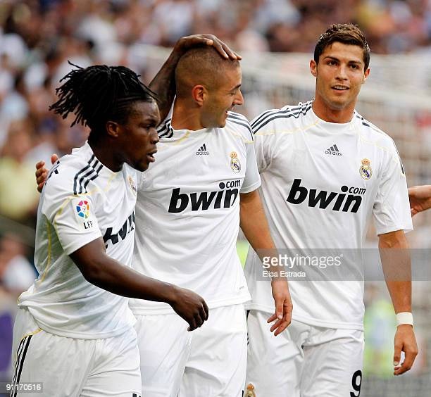Karim Benzema of Real Madrid celebrates his goal with Royston Drenthe and Cristiano Ronaldo during the La Liga match between Real Madrid and Tenerife...