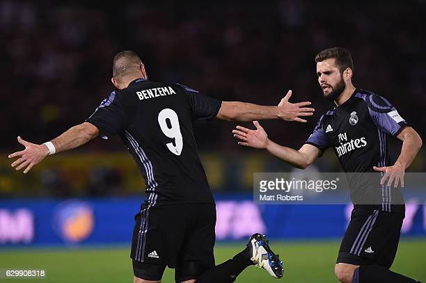Karim Benzema of Real Madrid celebrates kicking a goal with Nacho Fernandez during the FIFA Club World Cup Japan semifinal match between Club America...