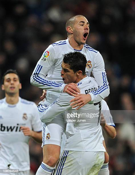 Karim Benzema of Real Madrid celebrates scoring his sides opening goal with his teammate Cristiano Ronaldo during the la liga match between Real...