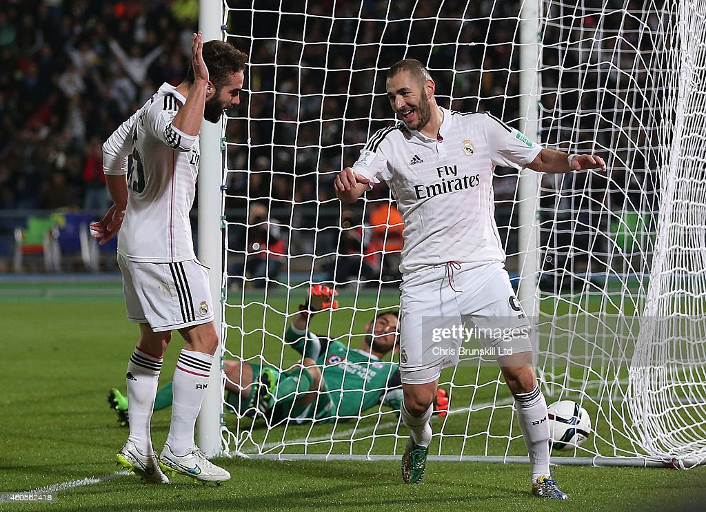 <a gi-track='captionPersonalityLinkClicked' href=/galleries/search?phrase=Karim+Benzema&family=editorial&specificpeople=796089 ng-click='$event.stopPropagation()'>Karim Benzema</a> of Real Madrid celebrates scoring his side's second goal with team-mate Dani Carvajal (L) during the FIFA Club World Cup Semi Final match between Cruz Azul and Real Madrid CF at Marrakech Stadium on December 16, 2014 in Marrakech, Morocco.