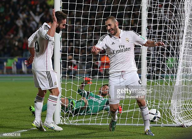 Karim Benzema of Real Madrid celebrates scoring his side's second goal with teammate Dani Carvajal during the FIFA Club World Cup Semi Final match...