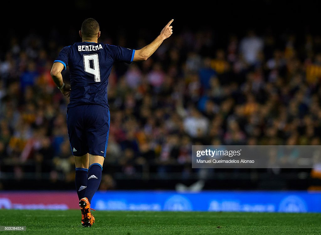 <a gi-track='captionPersonalityLinkClicked' href=/galleries/search?phrase=Karim+Benzema&family=editorial&specificpeople=796089 ng-click='$event.stopPropagation()'>Karim Benzema</a> of Real Madrid celebrates scoring his team's first goal during the La Liga match between Valencia CF and Real Madrid CF at Estadi de Mestalla on January 03, 2016 in Valencia, Spain.
