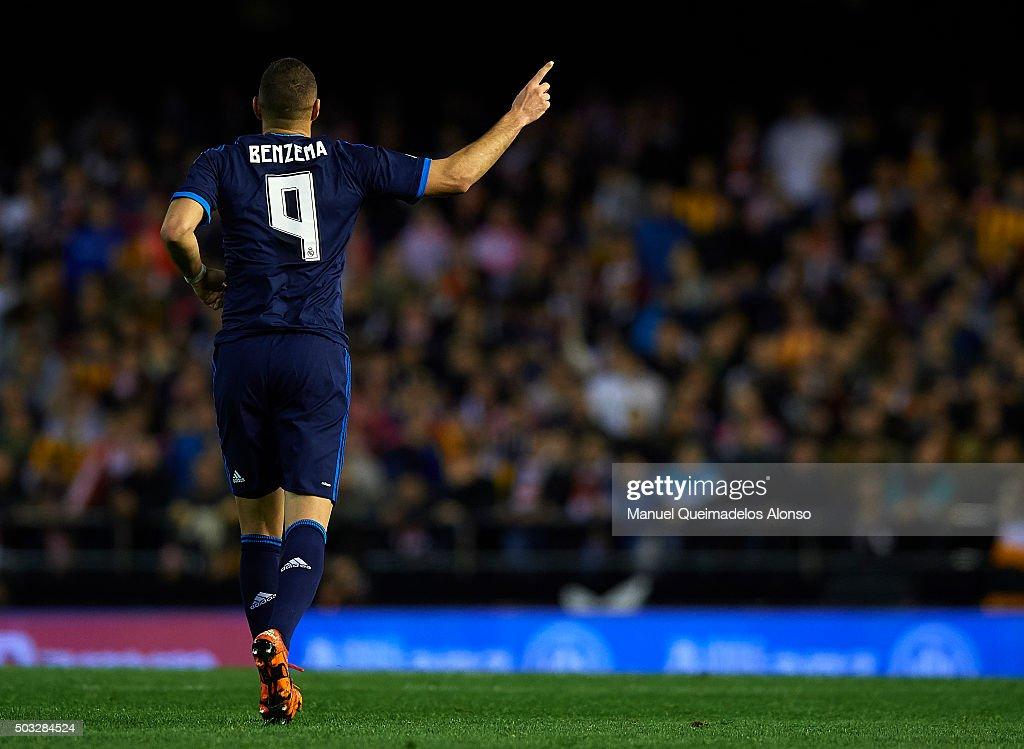 Karim Benzema of Real Madrid celebrates scoring his team's first goal during the La Liga match between Valencia CF and Real Madrid CF at Estadi de...