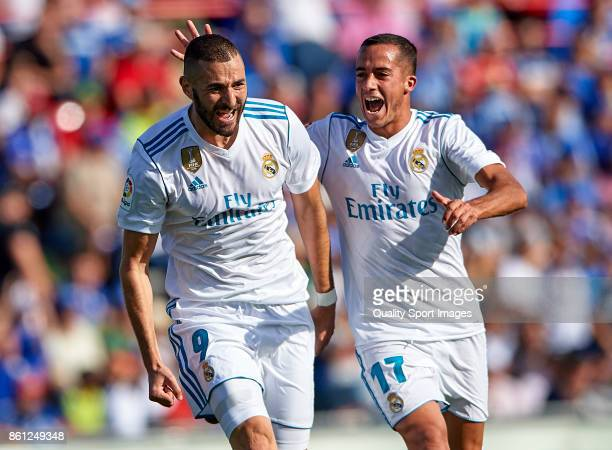 Karim Benzema of Real Madrid celebrates scoring his team's first goal with his teammate Lucas Vazquez during the La Liga match between Getafe and...