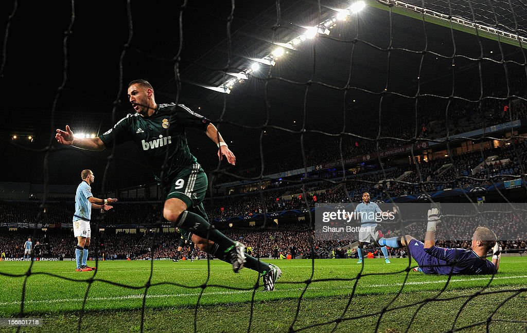 <a gi-track='captionPersonalityLinkClicked' href=/galleries/search?phrase=Karim+Benzema&family=editorial&specificpeople=796089 ng-click='$event.stopPropagation()'>Karim Benzema</a> of Real Madrid celebrates scoring the opening goal past <a gi-track='captionPersonalityLinkClicked' href=/galleries/search?phrase=Joe+Hart&family=editorial&specificpeople=1295472 ng-click='$event.stopPropagation()'>Joe Hart</a> of Manchester City during the UEFA Champions League Group D match between Manchester City FC and Real Madrid CF at the Etihad Stadium on November 21, 2012 in Manchester, England.