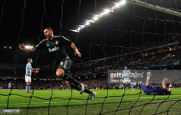Karim Benzema of Real Madrid celebrates scoring the opening goal past Joe Hart of Manchester City during the UEFA Champions League Group D match...