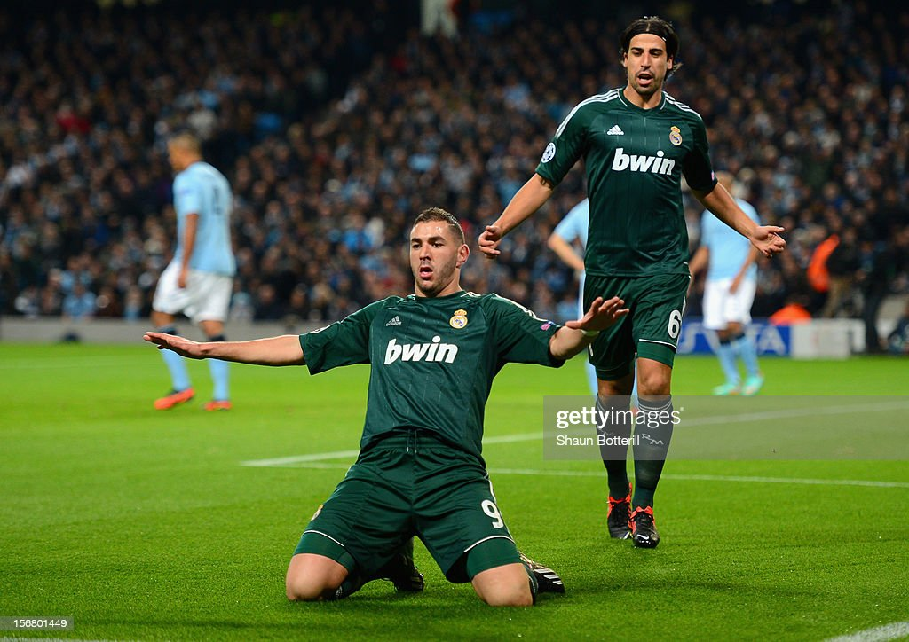 <a gi-track='captionPersonalityLinkClicked' href=/galleries/search?phrase=Karim+Benzema&family=editorial&specificpeople=796089 ng-click='$event.stopPropagation()'>Karim Benzema</a> of Real Madrid celebrates scoring the opening goal during the UEFA Champions League Group D match between Manchester City FC and Real Madrid CF at the Etihad Stadium on November 21, 2012 in Manchester, England.