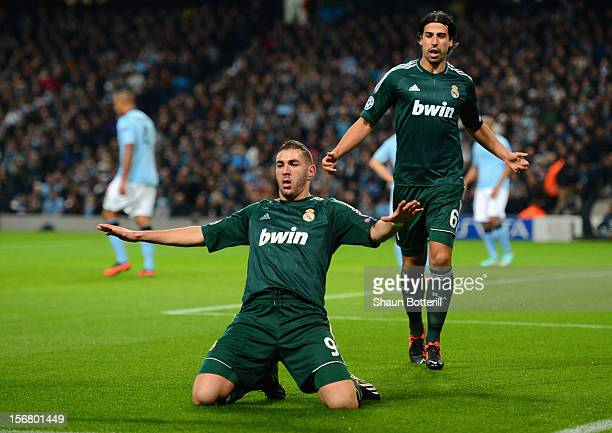 Karim Benzema of Real Madrid celebrates scoring the opening goal during the UEFA Champions League Group D match between Manchester City FC and Real...