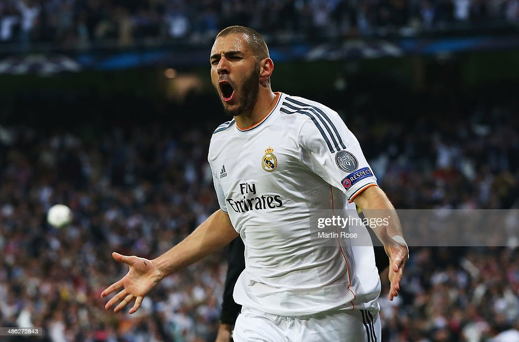 Karim Benzema of Real Madrid celebrates scoring the opening goal during the UEFA Champions League semifinal first leg match between Real Madrid and...
