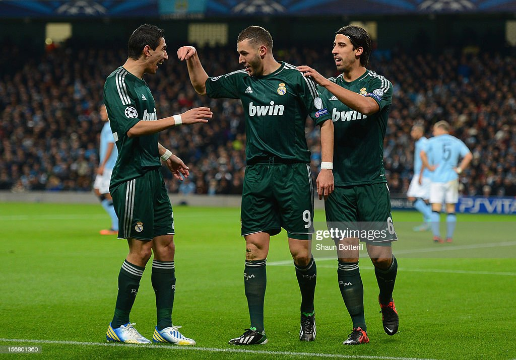 Karim Benzema of Real Madrid celebrates scoring the opening goal with team-mates Angel Di Maria (L) and Sami Khedira (R) during the UEFA Champions League Group D match between Manchester City FC and Real Madrid CF at the Etihad Stadium on November 21, 2012 in Manchester, England.