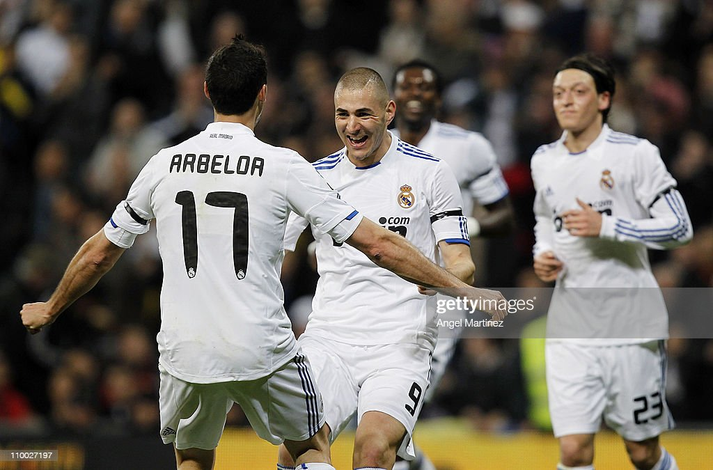 Karim Benzema of Real Madrid celebrates with Alvaro Arbeloa (L) after scoring his side opening goal during the La Liga match between Real Madrid and Hercules at Estadio Santiago Bernabeu on March 12, 2011 in Madrid, Spain.
