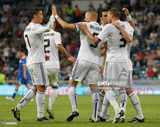 Karim Benzema of Real Madrid celebrates with Cristiano Ronaldo after scoring his side third goal during the La Liga match between Real Madrid and...