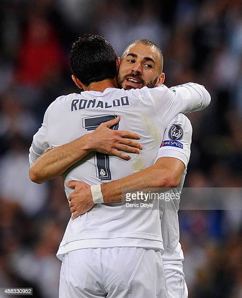 Karim Benzema of Real Madrid celebrates with Cristiano Ronaldo after scoring Real's opening goal during the UEFA Champions League Group A match...