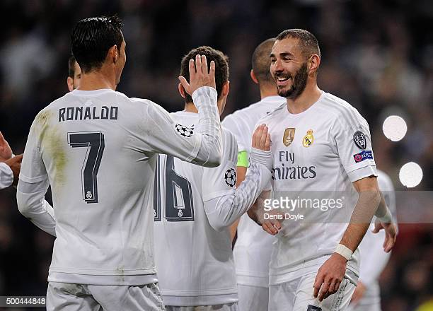 Karim Benzema of Real Madrid celebrates with Cristiano Ronaldo after scoring Real's 2nd goal during the UEFA Champions League Group A match between...