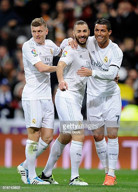 Karim Benzema of Real Madrid celebrates with Cristiano Ronaldo and Toni Kroos after scoring Real's opening goal during the La Liga match between Real...