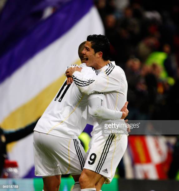 Karim Benzema of Real Madrid celebrates with fellow goalscorer Cristiano Ronaldo after scoring the 60 goal during the La Liga match between Real...