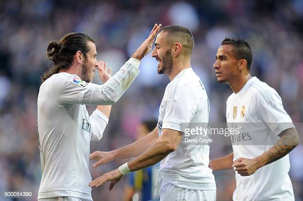 Karim Benzema of Real Madrid celebrates with Gareth Bale after scoring his team's opening goal during the La Liga match between Real Madrid CF and...