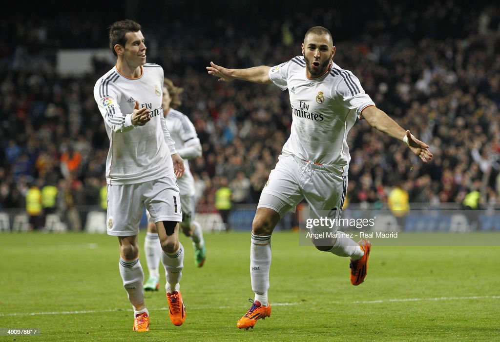 <a gi-track='captionPersonalityLinkClicked' href=/galleries/search?phrase=Karim+Benzema&family=editorial&specificpeople=796089 ng-click='$event.stopPropagation()'>Karim Benzema</a> (R) of Real Madrid celebrates with <a gi-track='captionPersonalityLinkClicked' href=/galleries/search?phrase=Gareth+Bale&family=editorial&specificpeople=609290 ng-click='$event.stopPropagation()'>Gareth Bale</a> after scoring the opening goal during the La Liga match between Real Madrid and RC Celta de Vigo at Estadio Santiago Bernabeu on January 6, 2014 in Madrid, Spain.