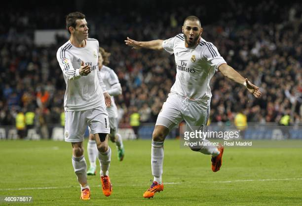 Karim Benzema of Real Madrid celebrates with Gareth Bale after scoring the opening goal during the La Liga match between Real Madrid and RC Celta de...