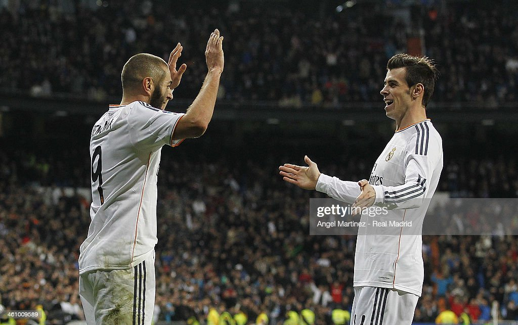 <a gi-track='captionPersonalityLinkClicked' href=/galleries/search?phrase=Karim+Benzema&family=editorial&specificpeople=796089 ng-click='$event.stopPropagation()'>Karim Benzema</a> (L) of Real Madrid celebrates with <a gi-track='captionPersonalityLinkClicked' href=/galleries/search?phrase=Gareth+Bale&family=editorial&specificpeople=609290 ng-click='$event.stopPropagation()'>Gareth Bale</a> after scoring the opening goal during the La Liga match between Real Madrid and RC Celta de Vigo at Estadio Santiago Bernabeu on January 6, 2014 in Madrid, Spain.