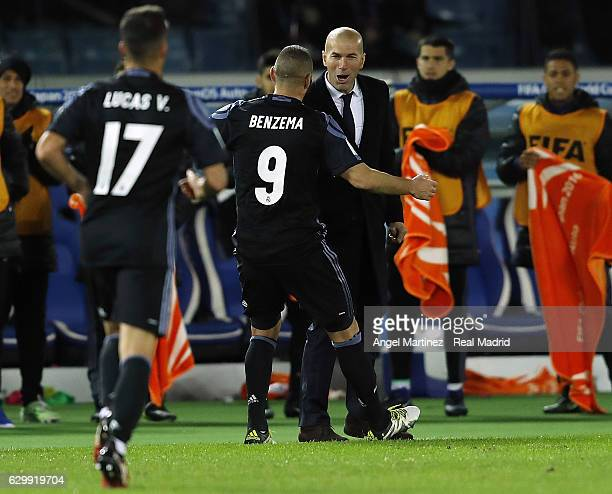 Karim Benzema of Real Madrid celebrates with head coach Zinedine Zidane after scoring the opening goal during the FIFA Club World Cup semi final...
