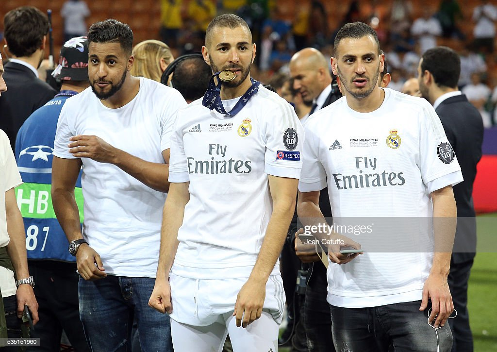 <a gi-track='captionPersonalityLinkClicked' href=/galleries/search?phrase=Karim+Benzema&family=editorial&specificpeople=796089 ng-click='$event.stopPropagation()'>Karim Benzema</a> of Real Madrid celebrates with his friends winning the UEFA Champions League final between Real Madrid and Club Atletico Madrid at Stadio Giuseppe Meazza, San Siro on May 28, 2016 in Milan, Italy.