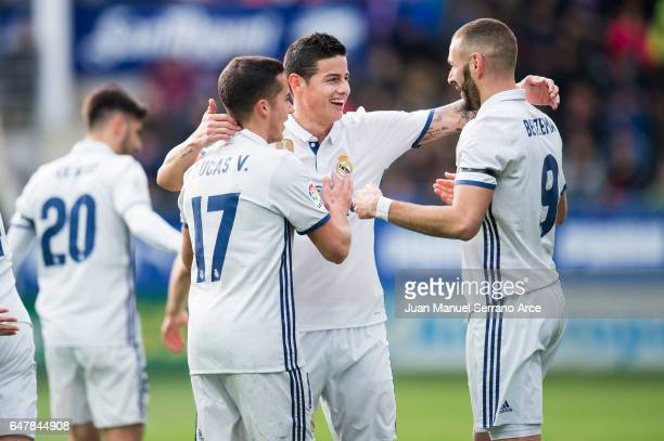 Karim Benzema of Real Madrid celebrates with his teammates James Rodriguez and Lucas Vazquez of Real Madrid after scoring his team's second goal...