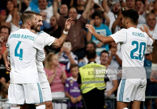Karim Benzema of Real Madrid celebrates with his teammates Sergio Ramos and Marco Asensio after scoring during the Spanish Super Cup return match...