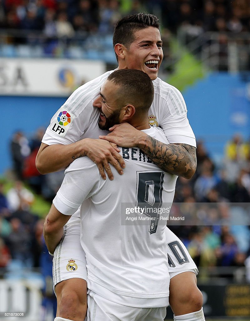 Karim Benzema of Real Madrid celebrates with James Rodriguez after scoring the opening goal during the La Liga match between Getafe CF and Real...