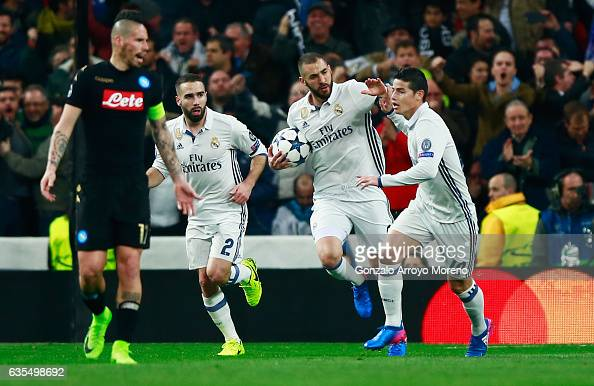 Karim Benzema of Real Madrid celebrates with James Rodriguez and Daniel Carvajal as he scores their first goal during the UEFA Champions League Round...