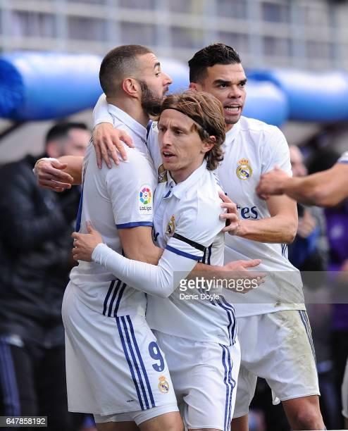 Karim Benzema of Real Madrid celebrates with Luka Modric and Pepe after scoring Real's 1st goal during the La Liga match between SD Eibar and Real...