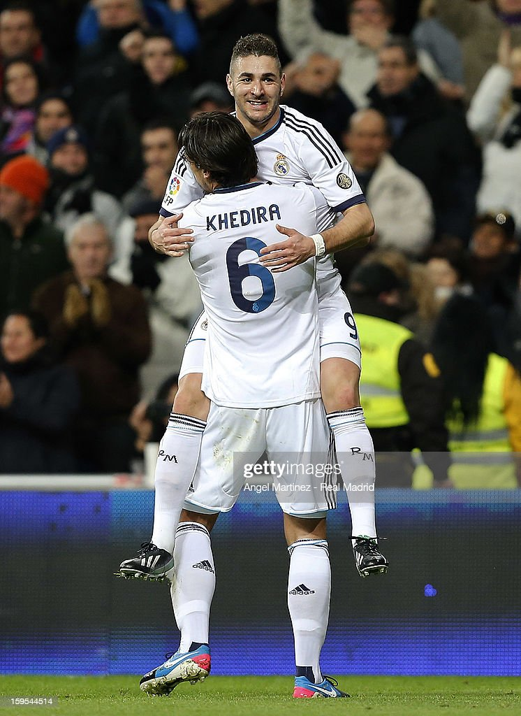 <a gi-track='captionPersonalityLinkClicked' href=/galleries/search?phrase=Karim+Benzema&family=editorial&specificpeople=796089 ng-click='$event.stopPropagation()'>Karim Benzema</a> (Up) of Real Madrid celebrates with <a gi-track='captionPersonalityLinkClicked' href=/galleries/search?phrase=Sami+Khedira&family=editorial&specificpeople=2513712 ng-click='$event.stopPropagation()'>Sami Khedira</a> after scoring the opening goal during the Copa del Rey quarter-final first leg match between Real Madrid and Valencia at Estadio Santiago Bernabeu on January 15, 2013 in Madrid, Spain.
