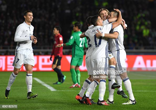 Karim Benzema of Real Madrid celebrates with team mates after scoring his sides first goal during the FIFA Club World Cup Final match between Real...