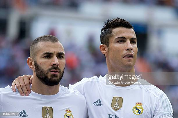 Karim Benzema of Real Madrid CF and his teammate Cristiano Ronaldo pose together at the line up prior to start the La Liga match between Real Madrid...