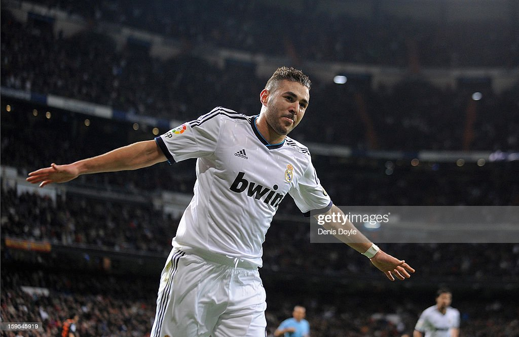 <a gi-track='captionPersonalityLinkClicked' href=/galleries/search?phrase=Karim+Benzema&family=editorial&specificpeople=796089 ng-click='$event.stopPropagation()'>Karim Benzema</a> of Real Madrid CF celebrates after scoring his team's opening goal during the Copa del Rey quarter final, first leg match between Real Madrid CF and Valencia CF at Estadio Santiago Bernabeu on January 15, 2013 in Madrid, Spain.