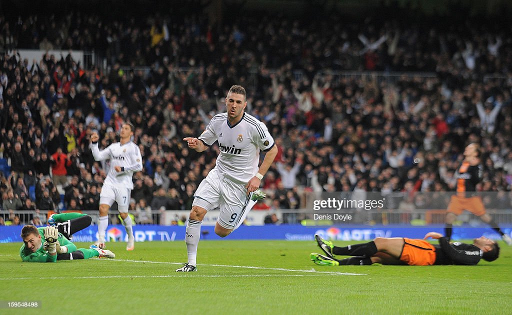 <a gi-track='captionPersonalityLinkClicked' href=/galleries/search?phrase=Karim+Benzema&family=editorial&specificpeople=796089 ng-click='$event.stopPropagation()'>Karim Benzema</a> of Real Madrid CF celebrates after scoring his team's opening goal during the Copa del Rey Quarter Final, 1st leg match between Real Madrid CF and Valencia CF at Estadio Santiago Bernabeu on January 15, 2013 in Madrid, Spain.