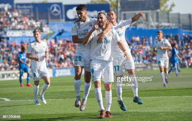Karim Benzema of Real Madrid CF celebrates after scoring his team's opening goal during the La Liga match between Getafe and Real Madrid at Coliseum...