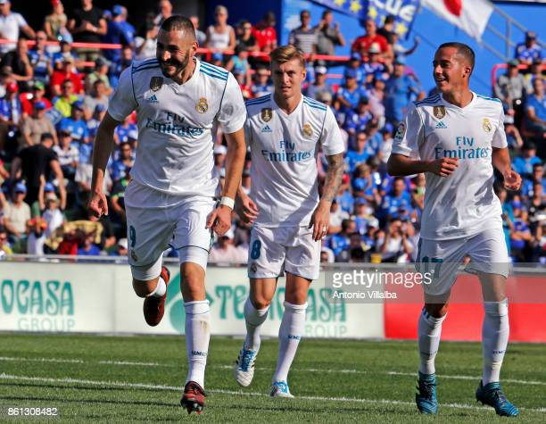 Karim Benzema of Real Madrid CF celebrates after scoring his team«s opening goal during the La Liga match between Getafe and Real Madrid at Coliseum...