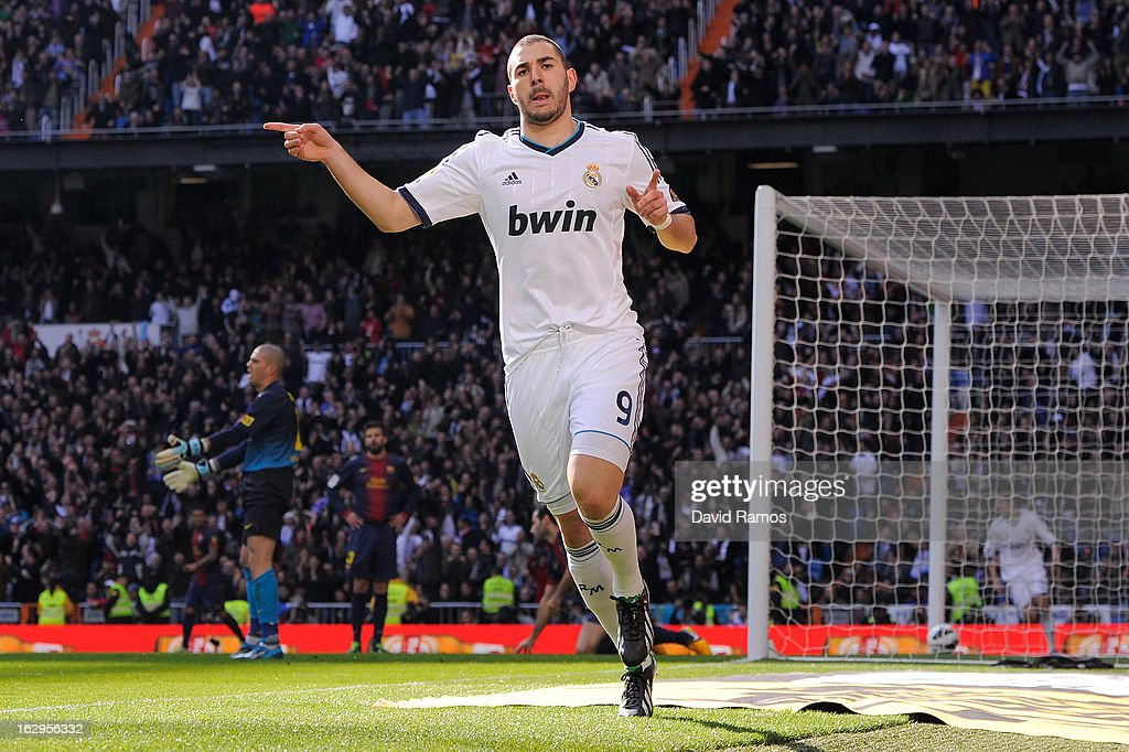 <a gi-track='captionPersonalityLinkClicked' href=/galleries/search?phrase=Karim+Benzema&family=editorial&specificpeople=796089 ng-click='$event.stopPropagation()'>Karim Benzema</a> of Real Madrid CF celebrates after scoring the opening goal during the La Liga match between Real Madrid CF and FC Barcelona at Bernabeu on March 2, 2013 in Madrid, Spain.