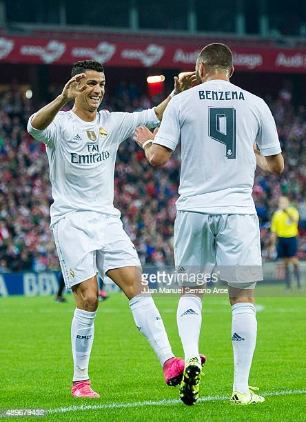Karim Benzema of Real Madrid CF celebrates after scoring with teammate Cristiano Ronaldo during the La Liga match between Athletic Club Bilbao and...
