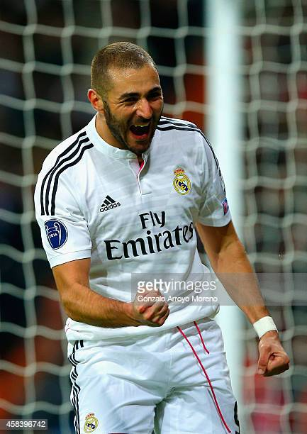 Karim Benzema of Real Madrid CF celebrates scoring the opening goal during the UEFA Champions League Group B match between Real Madrid CF and...