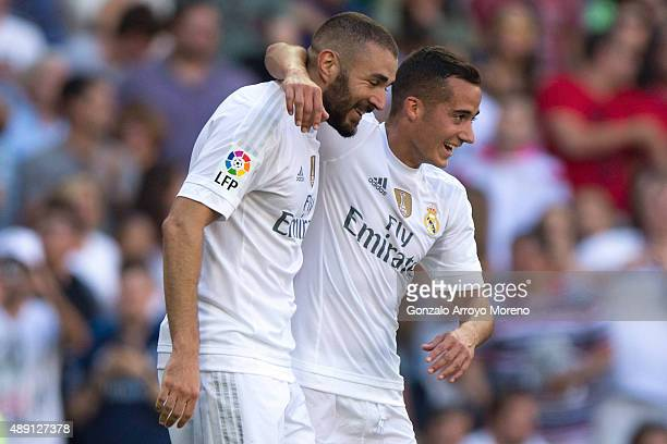 Karim Benzema of Real Madrid CF celebrates scoring their opening goal with teammate Lucas Vazquez during the La Liga match between Real Madrid CF and...