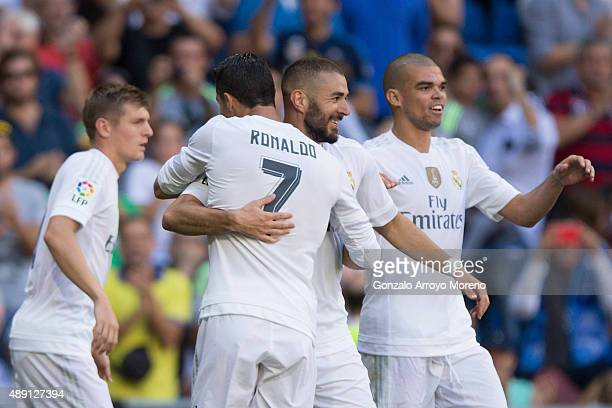 Karim Benzema of Real Madrid CF celebrates scoring their opening goal with teammates Pepe Cristiano Ronaldo and Toni Kroos during the La Liga match...
