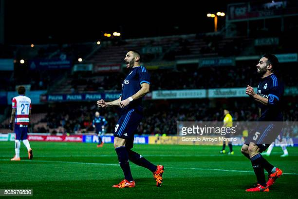 Karim Benzema of Real Madrid CF celebrates scoring their opening goal with teammate Daniel Carvajal during the La Liga match between Granada CF and...